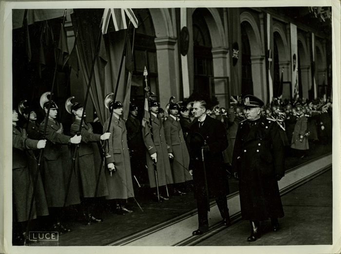 British Prime Minister Neville Chamberlain receives the red carpet treatment in Rome from Italian dictator Benito Mussolini. January 1939.