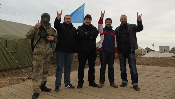 Ukrainian Neo-Nazis who organized the blockade of Crimea pose with the Turkish Grey Wolves neo-Nazi organization the members of which murdered the Russian pilot, Oleg Peshkov, in Syria, after his plane was downed by Turkish air force.