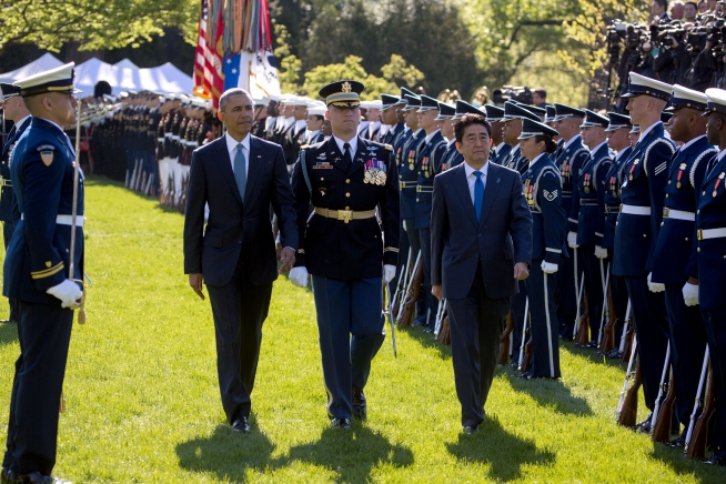 Barack Obama and Shinzo Abe review troops. 2015