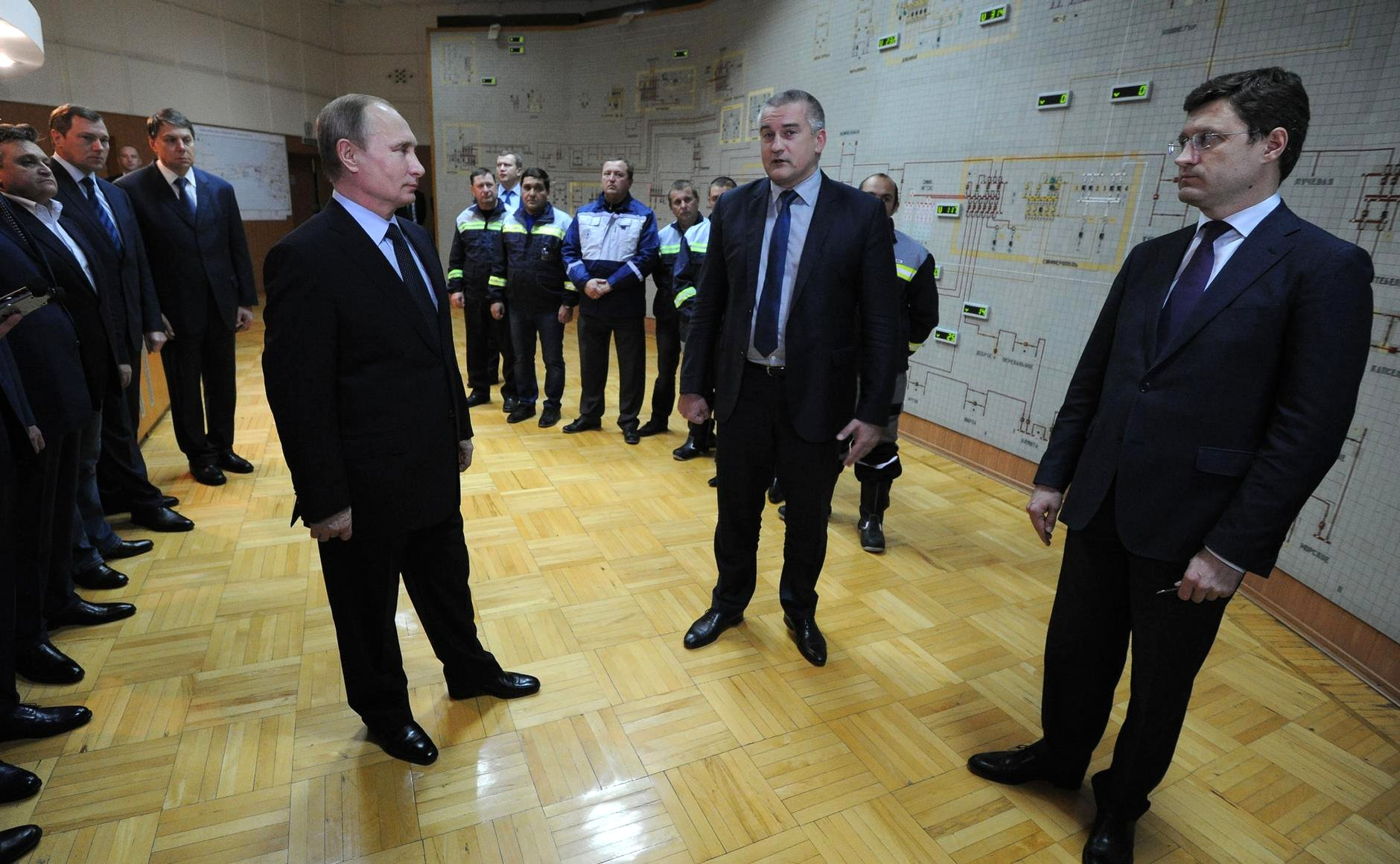 "After ""Right Sector"" and Crimean Tatar extremists blew up the electricity pylons which supplied power the Crimea on November 23, 2015, the peninsula went dark. On December 2, 2015, On photo: Vladimir Putin, head of Crimea Aksyonov and Russian Energy Minister Novak, Simferopol, December 2, 2015"