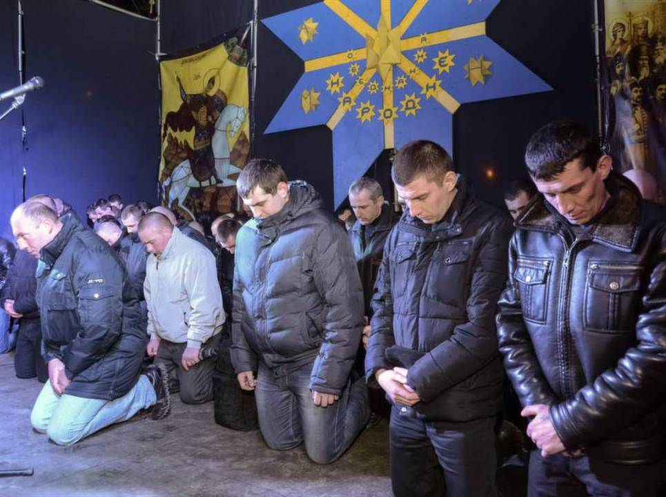 "Having come to power, local Bandera Nazis have put the police officers in Lvov to their knees and forced them to ask forgiveness ""peaceful protesters"" of forgiveness. Photo courtesy: Reuters"