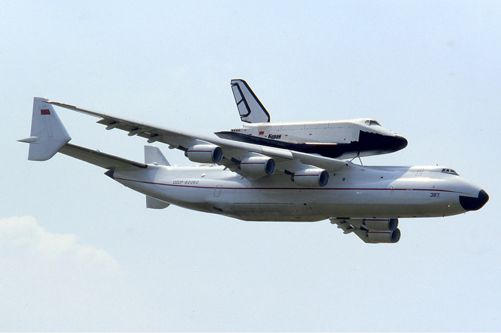 Antonov An-225, originally designed to transport space shuttles, was later used in commercial flights. Photo: with Buran space shuttle atop at the Paris Air Show, 1989