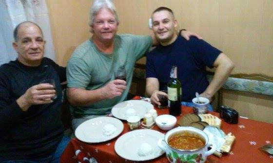 Texac (center) with new buddies Orion and Toro, toasting their good-bye to civilian life.