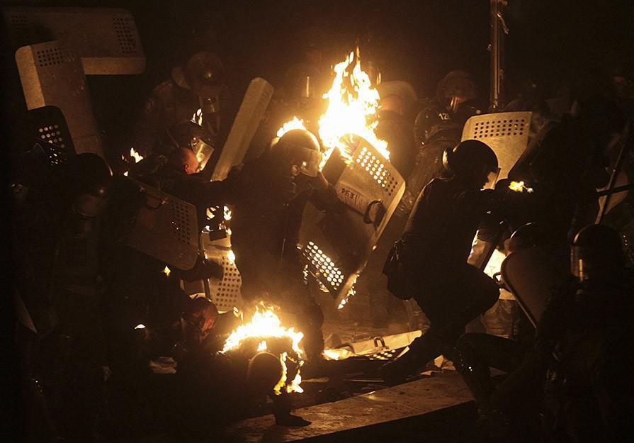 "Police being hit by ""peaceful pro-EU integration protesters'"" petrol bombs. Kiev, January 2014. Photo courtesy: Reuters"