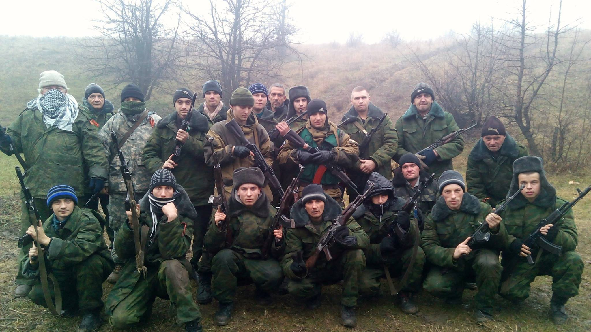 """'Novi partisani', posing in a frigid morning. """"Filin"""", """"The Owl"""".  Instructor for Vostok Brigade at Yasynuvata. That's him in the middle of the second row, looking down.  He was from Makeevka, DNR.  Died on 16 November defending his homeland against US-backed Nazis.  He was 22 years old and recently married to Julia. RESPECT, Brother."""