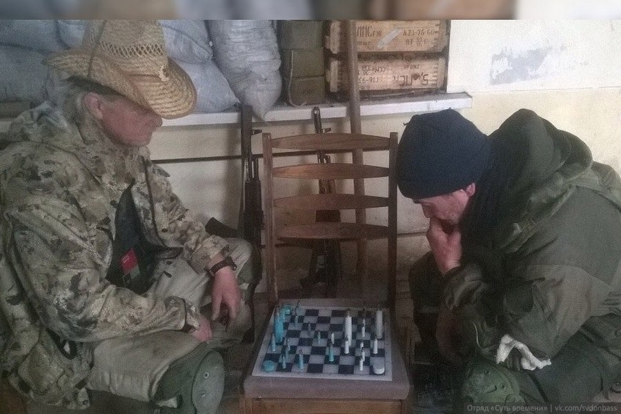 "Archive photo. ""Essence of Time"" unit in Donbass soldiers Texas and Pako playing chess. Spartak, April 2015."