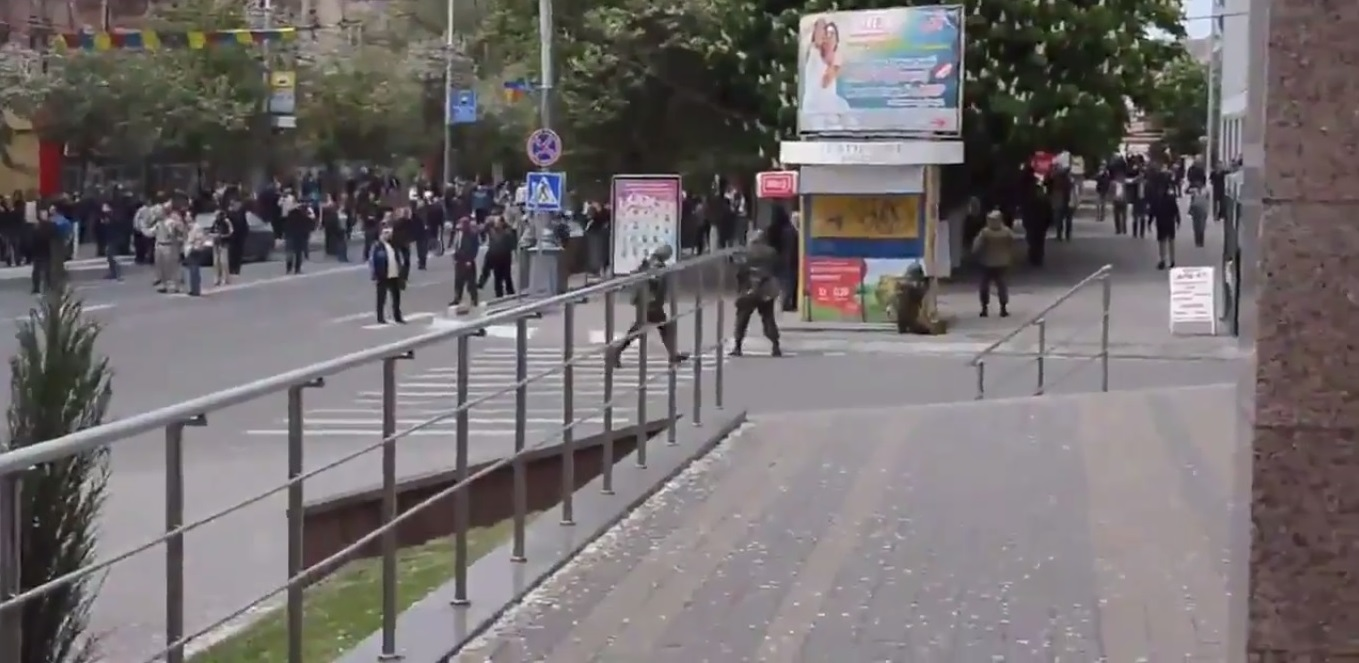 National Guard Nazis (four on the foreground) threaten the protesters, residents of the city. Seconds later Nazi opened fire, killing several people, and retreated. May 9, 2014
