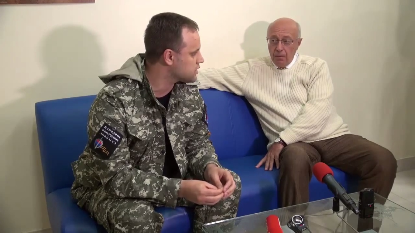 "Pavel Gubarev (left): ""Your recent criticism of Igor Strelkov... you have presented yourself not in very good light in military terms, I mean, you don't understand the meaning of the military situation in Slavyansk..."". Sergei Kurginyan: ""What is your rank?"" Pavel Gubarev ""Private."" Sergei Kurginyan: ""Why do you think that you, as a private, can evaluate my military training?"""