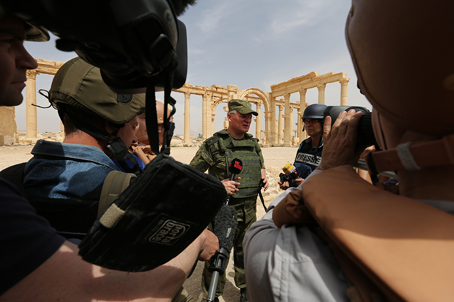 Igor Konashenkov speaking to journalists in Palmira, Syria, after the ancient city was liberated from ISIL terrorists by Syrian and Russian forces. April 7, 2016. Photo by mil.ru licensed under CC BY 4.0