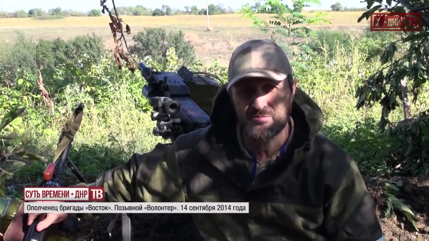 """Altay: """"How do you think this war will end?"""" Call sign Volunteer: """"With our victory, of course."""" September 14, 2014.  Still from EoT-DPR TV Issue 187"""