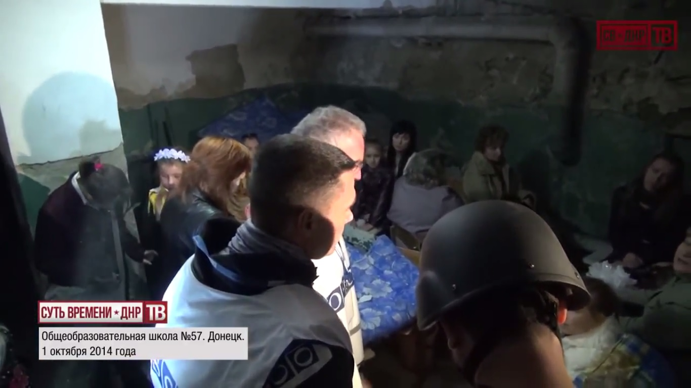 Kiev's punitive forces delivering on Poroshenko's promise to have children of Donbass hide in basements instead of going to school. Children hide in basement as OSCE inspects shelled school №57. October 1, 2014.  Still from EoT-DPR TV Issue 213