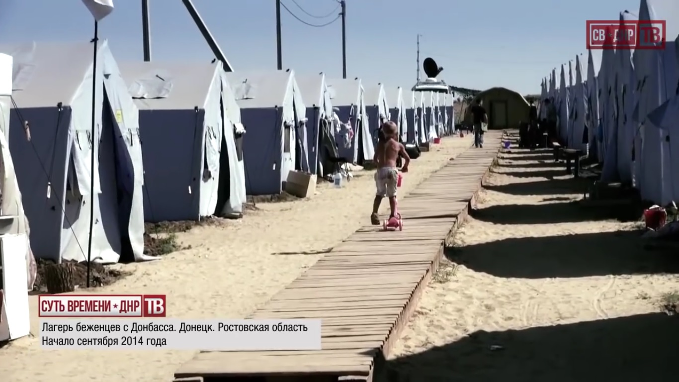 Igor Yudin, call sign Bolgarin, reporting from a refugee camp for residents of Ukraine in Rostov region, Russia. September 2014.  Still from EoT-DPR TV Issue 236