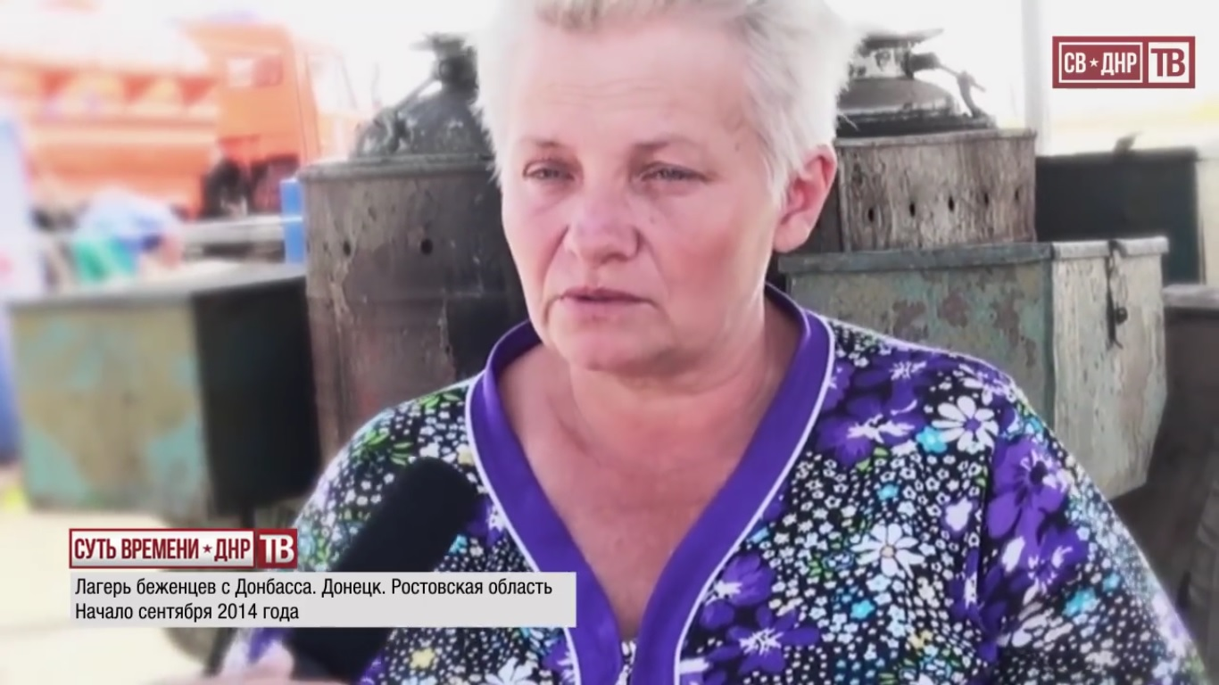 """We had to leave when it became too dangerous to leave the basement, impossible to buy anything, there was nothing in the stores. I feel great here, I go to the kitchen to help the girls. If not for them, what would we do? If they didn't give us such a shelter."" ""Do you plan to return to Lugansk after the war?"" ""Yes."" Rostov region, Russia. September 2014.  Still from EoT-DPR TV Issue 236"