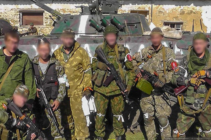 Essence of Time combat unit in Donbass members with a captured Ukrainian IFV.